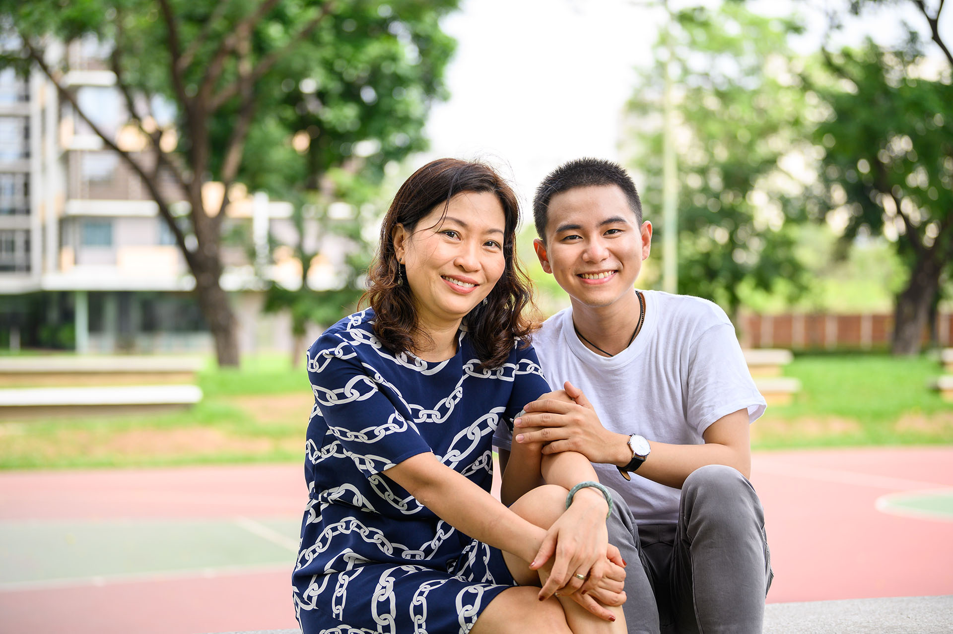 Vietnamese parent and child smiling